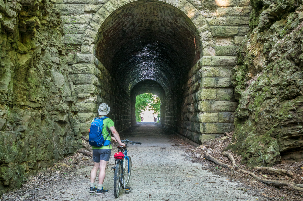 a male cyclist at MKT tunnel on Katy Trail.