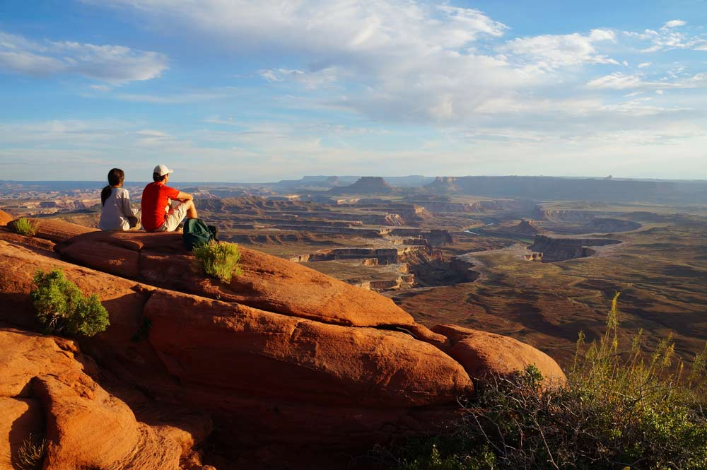 Two hikers enjoy the view.